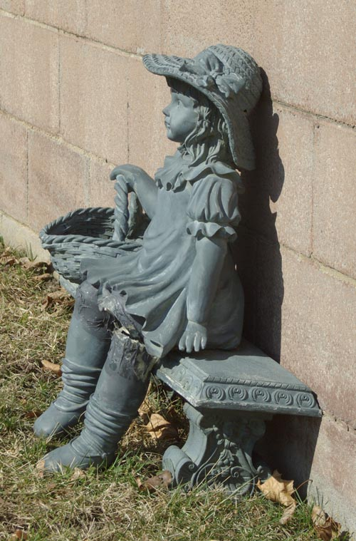 photo of decorative bench with little girl
