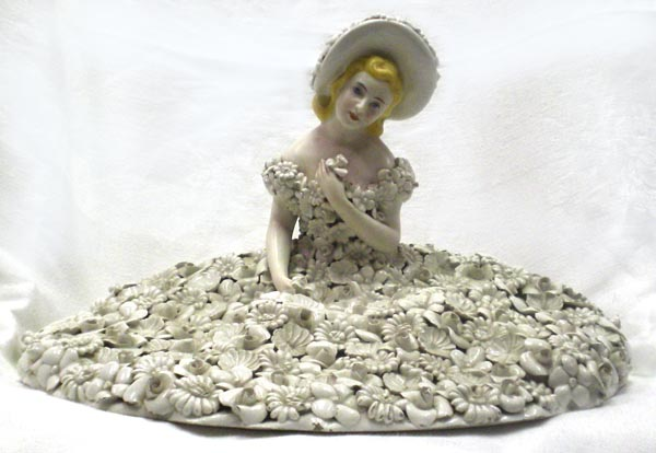 photo of porcelain figure in flowers