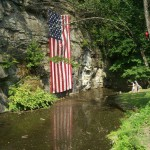 American flag reflected in pond