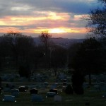 photo of sunset over cemetery