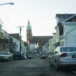 photo of narrow street with church