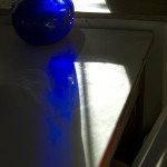 morning sun through blue pitcher