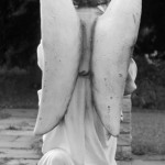 angle statue with bare feet