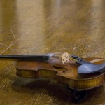 violin on an oak table
