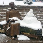 female sculpture and snowman