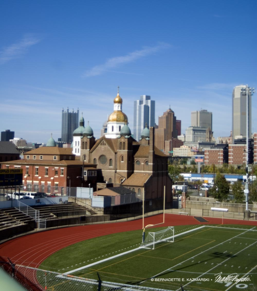 The church, the city and the high school football field.